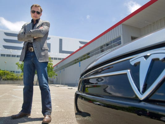 Tesla talking to Google about driverless electric cars