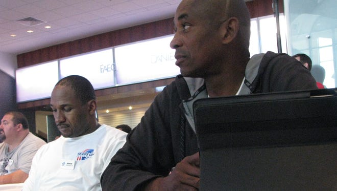 Anthony Davis, left, and Preston Dennard participate at the Heads Up program Wednesday in Indianpolis. Davis, the former linebacker, is among those players in attendance who are also suing the NFL.