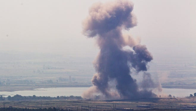 An explosion near the Syrian village of Al' Rafide at the border with Israel on May 7.