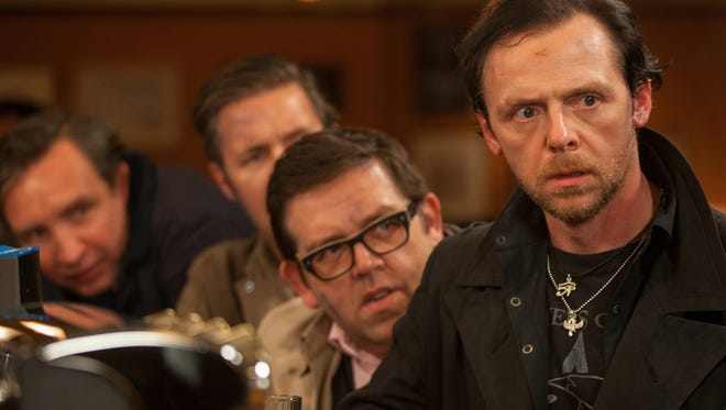 Leather-clad Gary (Simon Pegg) rounds up his old friends for a night of drinking that takes a turn for the weird in the comedy 'The World's End.'