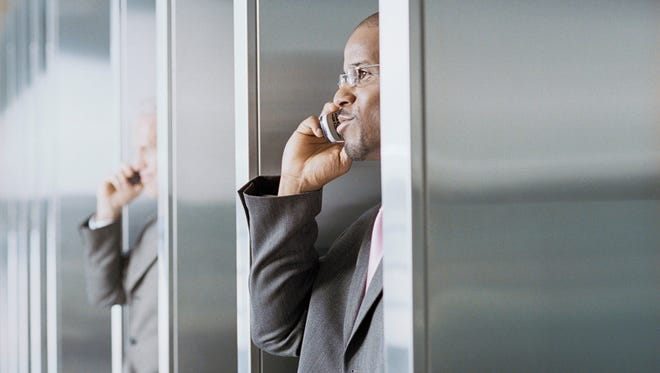 Yes, you probably should take your cellphone away from the cubicle when making calls. But the bathroom stall probably isn't the best alternative.