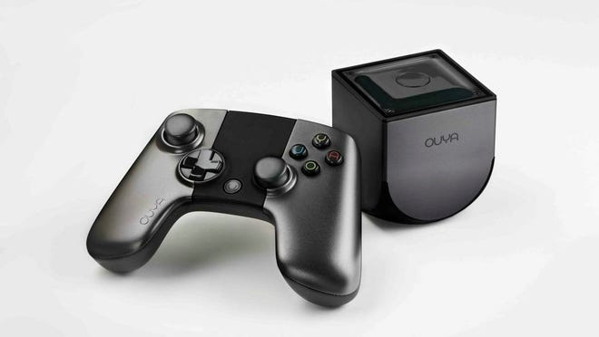 The Ouya video game console, scheduled to arrive in stores June 25.