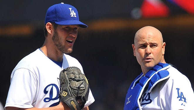 Dodgers pitcher Clayton Kershaw, left, is 3-2 with a 1.66 ERA in seven games. He has 52 strikeouts, tied for fourth in the major leagues. He also has one shutout.