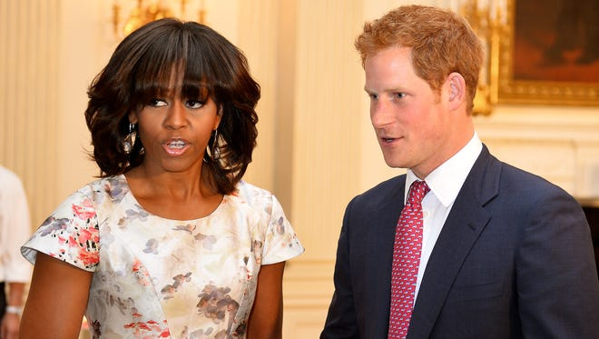 Prince Harry turns up for surprise visit at White House tea party co-hosted by first lady Michelle Obama for military moms.