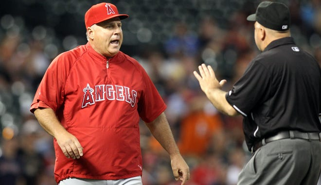 Angels manager Mike Scioscia attempts to enlighten umpires on rule 3.05(b).