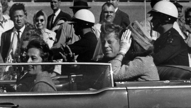 President John F. Kennedy is seen riding in motorcade approximately one minute before he was shot in Dallas, Tx. on Nov. 22, 1963.