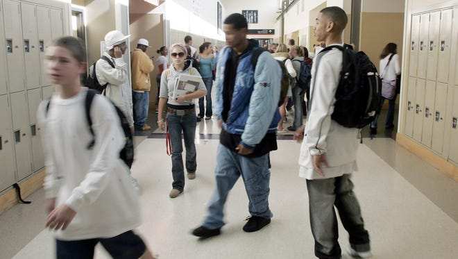 Students at a Seattle high school walk through the halls between classes.