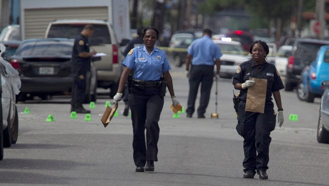 New Orleans Police investigate shooting at the intersection Frenchman Street at N. Villere on Mother's Day in New Orleans, Sunday.