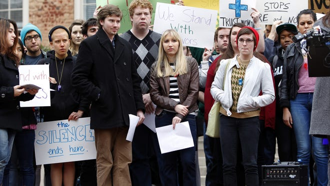 UNC-Chapel Hill sophomore Landen Gambill, center, stands with supporters during a rally Friday March 1, 2013, on the steps of the South Building on campus. Gambill was informed by the student-run judicial system that she has been charged with an honor code violation for speaking out about alleged abuse and sexual violence.