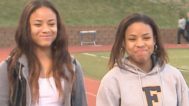 Jordan Dickerson, left, and Robin Jeter discovered only in mid-January that they are sisters. They went to high school about 10 miles away from one another and met at a track meet when friends commented on how much they looked alike.