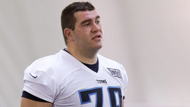 Tennessee Titans tackle Matt Sewell takes a break during NFL football rookie minicamp practice on Friday, May 10, 2013, in Nashville, Tenn.