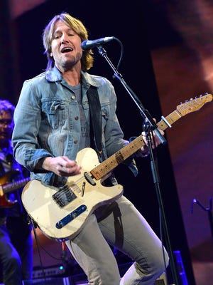 Keith Urban performs at the Crossroads Guitar Festival in New York on April 13.