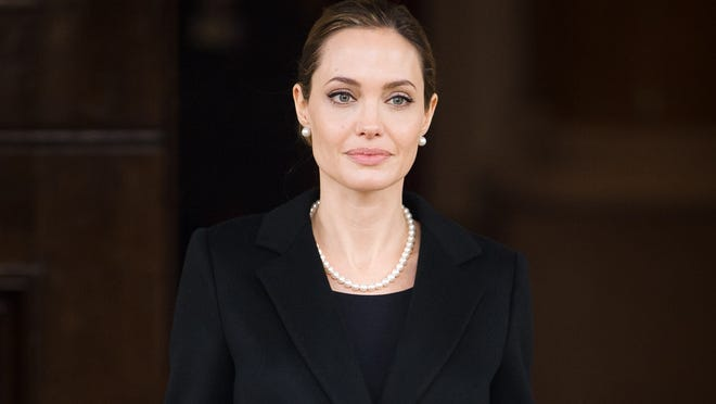 Actress and humanitarian campaigner Angelina Jolie leaves Lancaster House in London on April 11 after speaking during an announcement of funding to address conflict sexual violence on the sidelines of the G8 Foreign Ministers meeting.