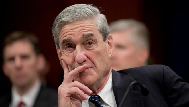 FBI Director Robert Mueller appears at a House Intelligence Committee hearing on April 11.