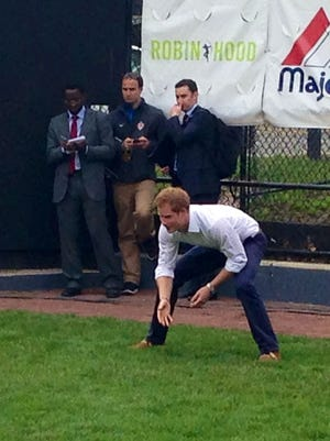 Prince Harry plays catch on the Harlem RBI field on Tuesday.