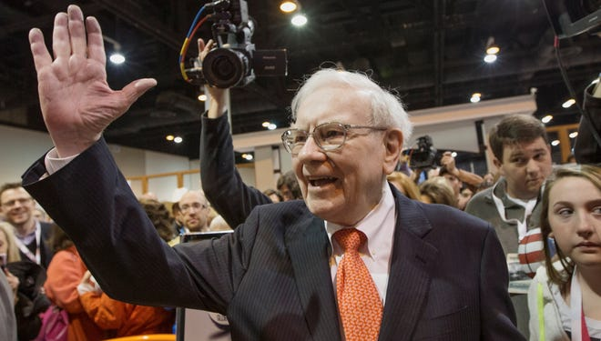 Warren Buffett greets investors at the Berkshire Hathaway shareholders meeting, in Omaha on May 4, 2013.