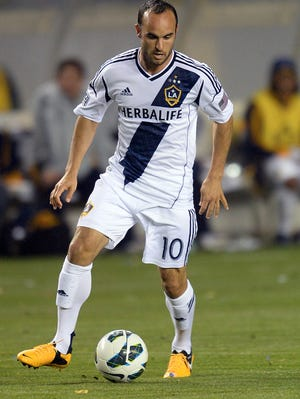 Landon Donovan, shown playing for the Galaxy in the MLS, has been left off the current team that will be playing in World Cup qualifying games