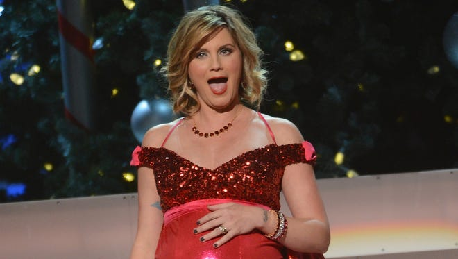 A then-pregnant Jennifer Nettles performs during the 2012 Country Christmas concert   in Nashville.