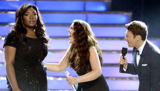 """Winner Candice Glover,  is stunned as finalist Kree Harrison and host Ryan Seacrest congratulate her during the """"American Idol 2013"""" finale."""