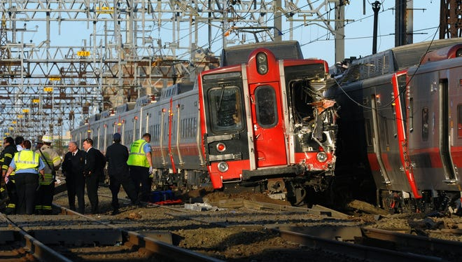 Emergency workers arrive at the scene of a train collision, Friday.