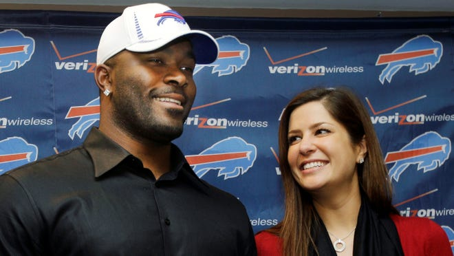 """In this March 15, 2012 photo, Buffalo Bills' Mario Williams poses for a photo with his fiancee Erin Marzouki smile after an NFL football news conference in Orchard Park, N.Y. Here's one thing that can happen when love goes bad: Bills defensive end Mario Williams is suing his ex-fiancee, demanding she return a $785,000 diamond engagement ring. In response, Marzouki has filed a countersuit, calling Williams' demands """"ridiculous."""""""