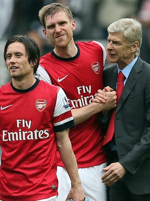 Arsenal's Tomas Rosicky, Per Mertesacker and manager Arsene Wenger celebrate after the 1-0 win over Newcastle.