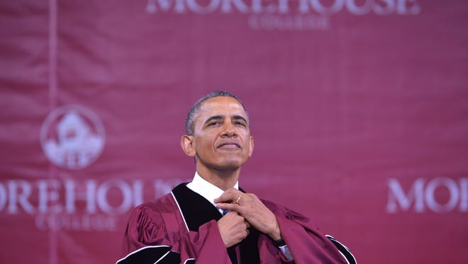 President Obama before receiving his honorary doctorate of law degree, after delivering the commencement address during a ceremony at Morehouse College on May 19, 2013 in Atlanta, Georgia.