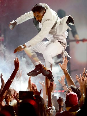 LAS VEGAS, NV - MAY 19:  Singer Miguel performs onstage during the 2013 Billboard Music Awards at the MGM Grand Garden Arena on May 19, 2013 in Las Vegas, Nevada.  (Photo by Ethan Miller/Getty Images) ORG XMIT: 167011895 ORIG FILE ID: 169079634