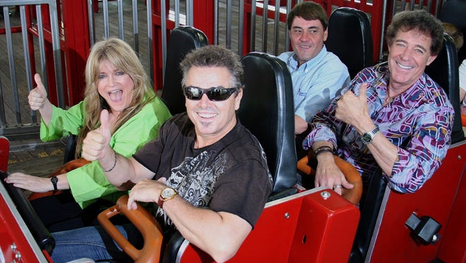 'Brady Bunch' stars Susan Olsen and Christopher Knight, front row, and Barry Williams, second row right, enjoy a ride on the Racer at Kings Island on May 19. They were in Mason, Ohio, to mark the 40th anniversary of the taping of a 'Brady' episode at Kings Island.