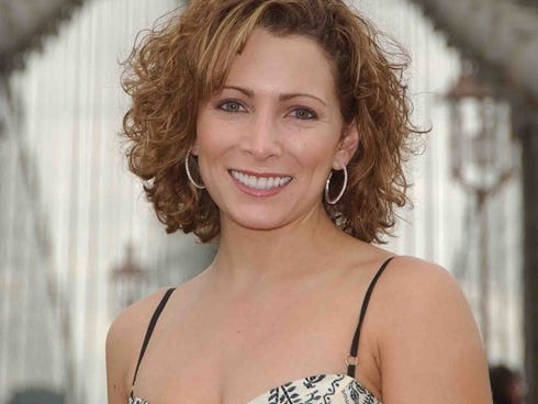 In a file photo from 2005, Shannon Miller poses in front of the Brooklyn Bridge in New York.