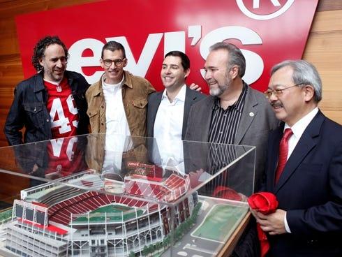 Levi's Brand President James Curleigh, Levi's CEO Chip Bergh, San Francisco 49ers CEO Jed York, Santa Clara Mayor Jamie Matthews and San Francisco Mayor Ed Lee stand near a model of the 49ers' new NFL football stadium.