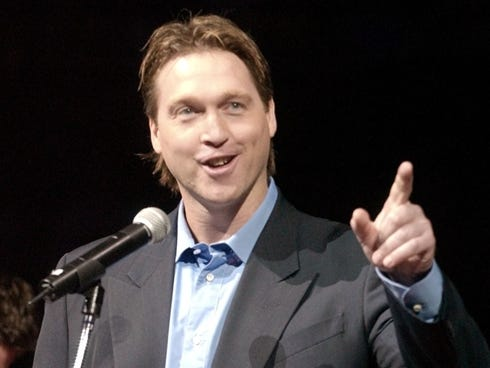 Patrick Roy, front, jokes during his speech at the retirement ceremony for his number 33 with his former teammates on the Colorado Avalanche on Tuesday, Oct. 28, 2003.