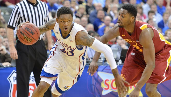 Kansas Jayhawks guard Ben McLemore (23) drives by Iowa State Cyclones forward Melvin Ejim (3) in the first half during the quarterfinals of the Big 12 tournament at the Sprint Center.