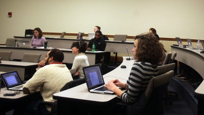 Students attend a class at the University of Michigan in Ann Arbor, Mich., on Jan. 24, 2013.