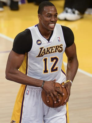 Los Angeles Lakers center Dwight Howard (12)  is torn between the Lakers and Rockets.