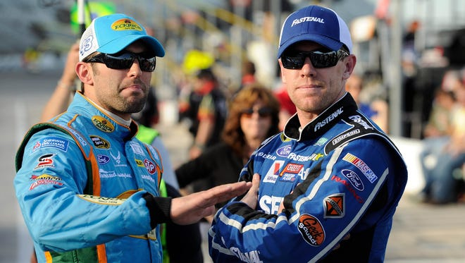 Aric Almirola, left, with fellow driver Carl Edwards, has the Air Force as his primary sponsor. He calls NASCAR an All-American sport.
