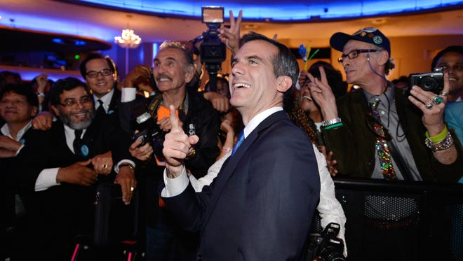 Eric Garcetti celebrates his victory in the Los Angeles mayor's race.