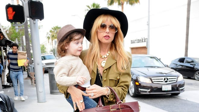 Rachel Zoe totes her son, Skyler Berman, on April 30 in Los Angeles.  Zoe has entered the hair-dry business.