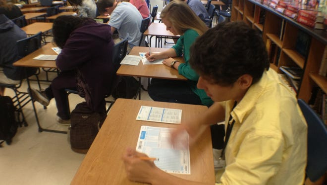 Students at J.L. Mann High School in Greenville, S.C., take an exam. A proposal in the state Legislature would eliminate an exit exam for a diploma.