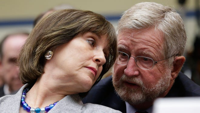 Lois Lerner, director of the Internal Revenue Service's exempt organizations group, consults with her attorney, William Taylor, before invoking her Fifth Amendment right to not testify during a House Oversight and Government Reform Committee hearing May 22 on Capitol Hill.