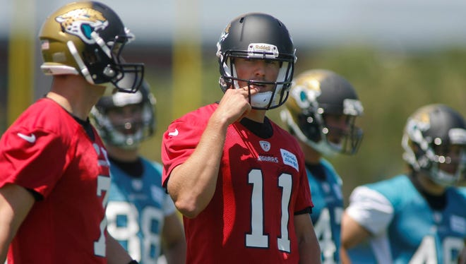 Jaguars QB Blaine Gabbert may have to fend off Chad Henne, left, for the starting job.