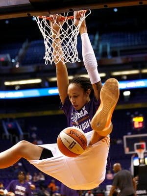 Brittney Griner throws down for the Mercury in a preseason pregame warmup.