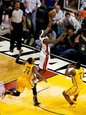 Heat forward LeBron James gets completely open for a game-winning layup in overtime of Game 1 of the Eastern Conference finals.