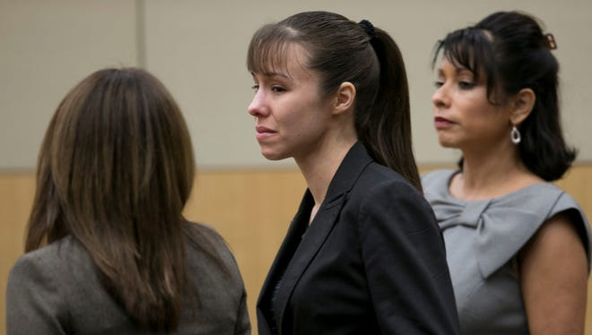 Jodi Arias stands as the jury is excused after the verdict for sentencing was declared a hung jury for her first degree murder conviction at Maricopa County Superior Court in Phoenix, Ariz., on Thursday.