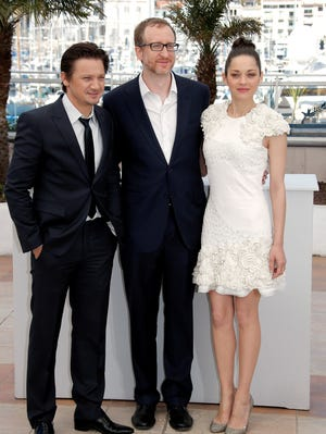 Actor Jeremy Renner, director James Gray, and actor Marion Cotillard during a photo call for The Immigrant at the Cannes Film Festival,  May 24, 2013.