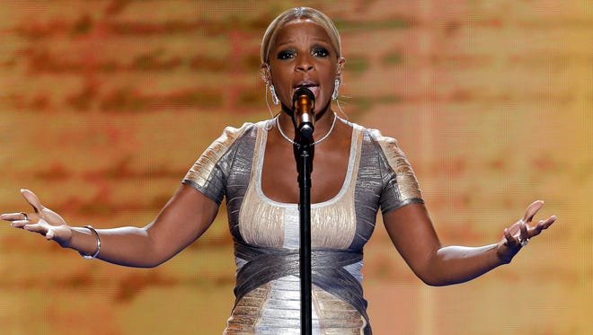 Mary J. Blige performs during the Democratic National Convention in Charlotte, N.C. Blige and her husband have been hit with a $3.4 milion tax lien by the IRS.
