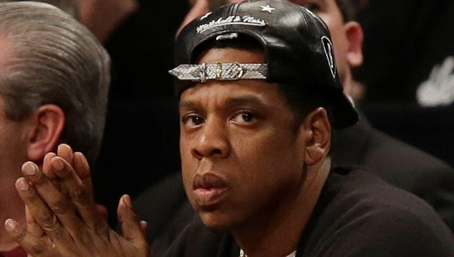 Jay-Z watches during the second quarter of Game 1 between the Chicago Bulls and the Brooklyn Nets in the first round of the NBA basketball playoffs at the Barclays Center Saturday, April 20, 2013, in New York.