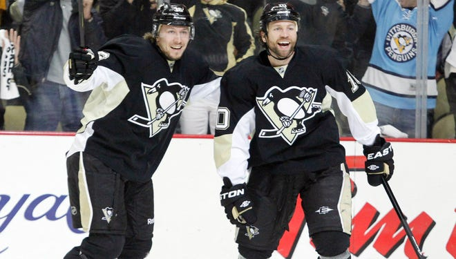 Penguins center Jussi Jokinen (left) and left wing Brenden Morrow (10) celebrate after Morrow scored a goal against the Senators during the first period.