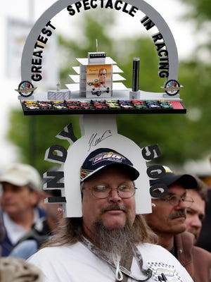 Mark Brandt wears his custom Indy 500 head gear as he waits in line during an autograph session before the public drivers meeting for the Indianapolis 500 auto race at the Indianapolis Motor Speedway in Indianapolis on Saturday.