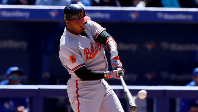 Orioles center fielder Adam Jones hits a solo home run in the seventh inning against the Blue Jays in Saturday's 6-5 victory.